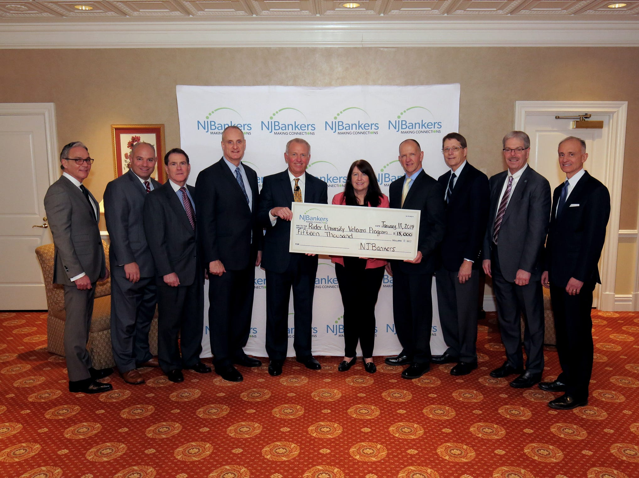 The Trustees of the NJBankers Charitable Foundation gather together to present $15,000 to representatives of the Rider University Veterans and Military Affairs Office. Through the program, the University supports the educational needs of Veterans. (Left to right): James Vaccaro, chairman/president/CEO, Manasquan Bank; Michael Affuso, NJBankers EVP/director of Government Relations; Louis Anthony Costantino, Jr., managing director/industry manager, JPMorgan Chase Bank; Thomas Kemly, president/CEO, Columbia Bank; John McWeeney, Jr., NJBankers president/CEO; Lisa Teach, Entrepreneurship Center director and Ron Cook, associate dean for Graduate Programs, CBA, professor of Entrepreneurship, both of Rider University; James Silkensen, director, Somerset Savings Bank; Thomas Shara, president/CEO, Lakeland Bank; and Richard Siderko, president/CEO, Bankers Cooperative Group.
