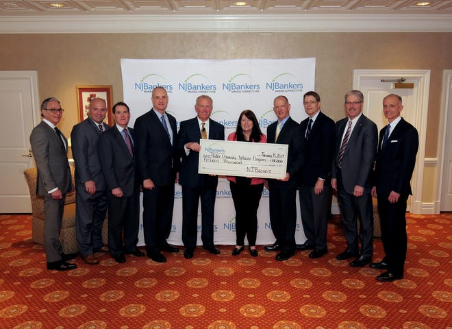 The Trustees of the NJBankers Charitable Foundation gather together to present $15,000 to representatives of the Rider University Veterans and Military Affairs Office. Through the program, the University supports the educational needs of Veterans. (Left to right): James Vaccaro, chairman/president/CEO, Manasquan Bank; Michael Affuso, NJBankers EVP/director of Government Relations; Louis Anthony Costantino, Jr., managing director/industry manager, JPMorgan Chase Bank; Thomas Kemly, president/CEO, Columbia Bank; John McWeeney, Jr., NJBankers president/CEO; Lisa Teach, Entrepreneurship Center director and Ron Cook, associatedean for Graduate Programs, CBA, professor of Entrepreneurship, both of Rider University; James Silkensen, director, Somerset Savings Bank; Thomas Shara, president/CEO, Lakeland Bank; and Richard Siderko, president/CEO, Bankers Cooperative Group.