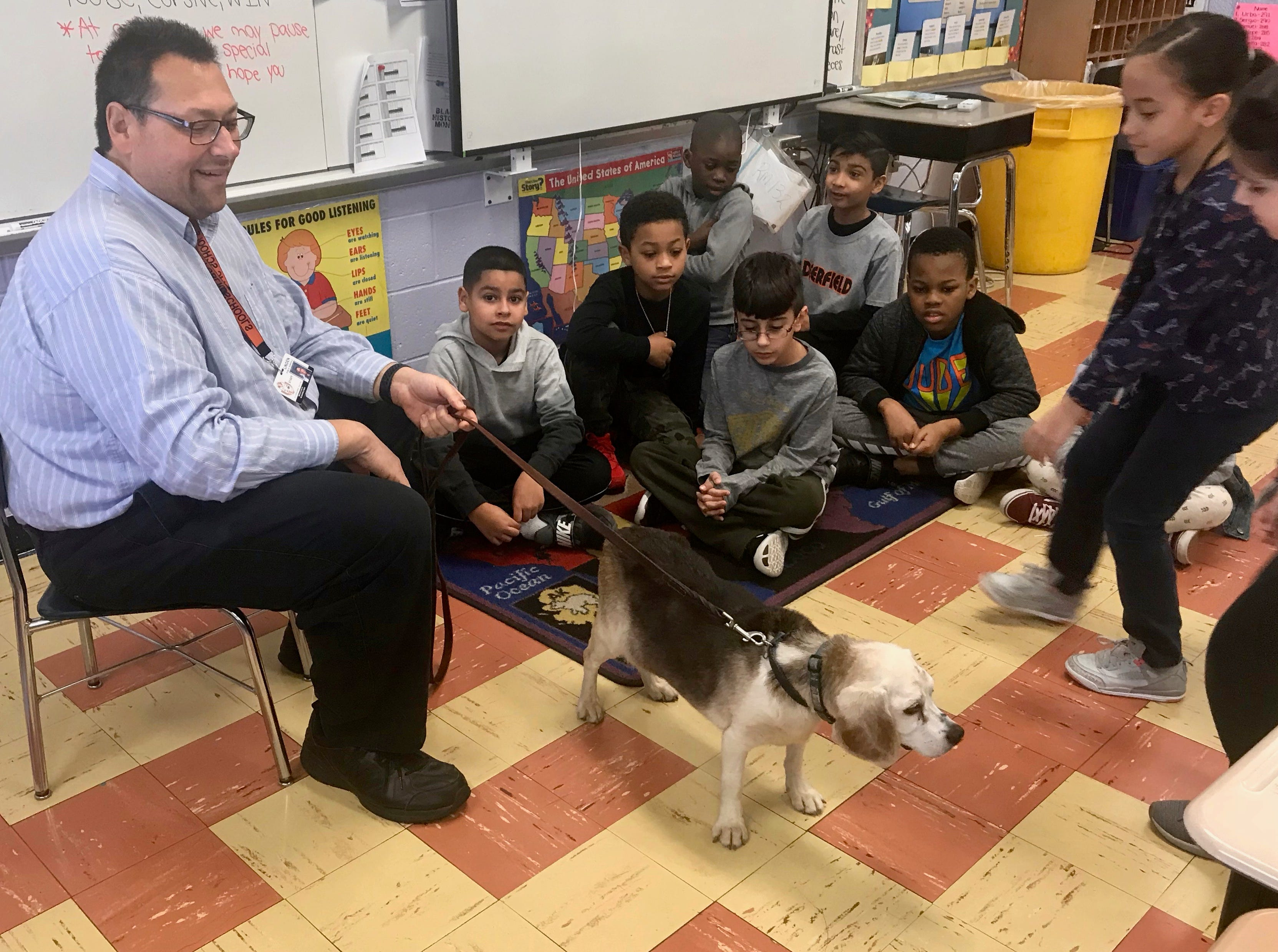 Walter Schweikardt, an elementary math coach in Linden Public Schools, introducing his dog, Buster, a retired therapy dog, to students in Casey Mulroe's class at Deerfield School No. 9.