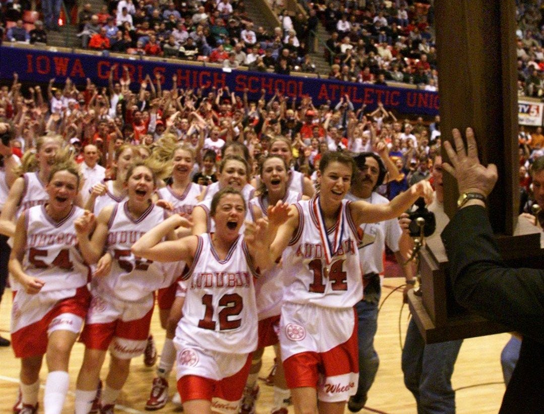 1999: Audubon players rush for their trophy after defeating Denver at the state girls' basketball tournament. Register file photo