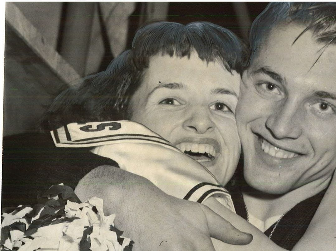 1958: Vivian Fleming, EmersonÕs high-scoring forward, hugs her boyfriend Ray Seipold, an Emerson cheerleader, after the teramÕs semifinal victory over State Center. Register file photo