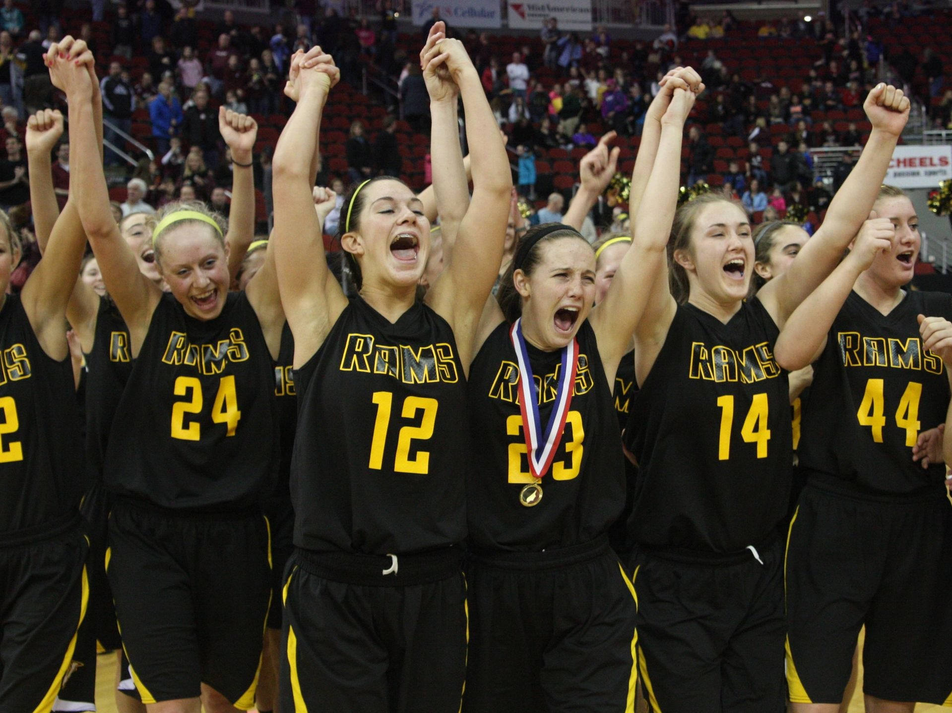 2013: Members of the Southeast Polk girls' basketball team including seniors, from left, Jessica Gardner (partially shown), Victoria Bricker (24), Megan Bianchi (12), Caitlin Ingle (23) and Dakota Taylor (14) cheer as they accept the Class 5-A championship trophy Saturday after beating Dowling Catholic, 43-34. Adam Wilson/Register file photo