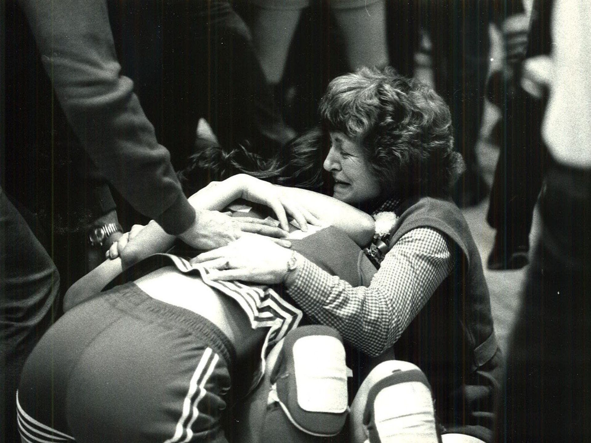 1980: Guard Le Ann Hejlik and a Britt fan smother teammate Barbara Burgart after beating Guthrie Center in the final seconds, 62-61, for the Class 2-A crown. Register file photo