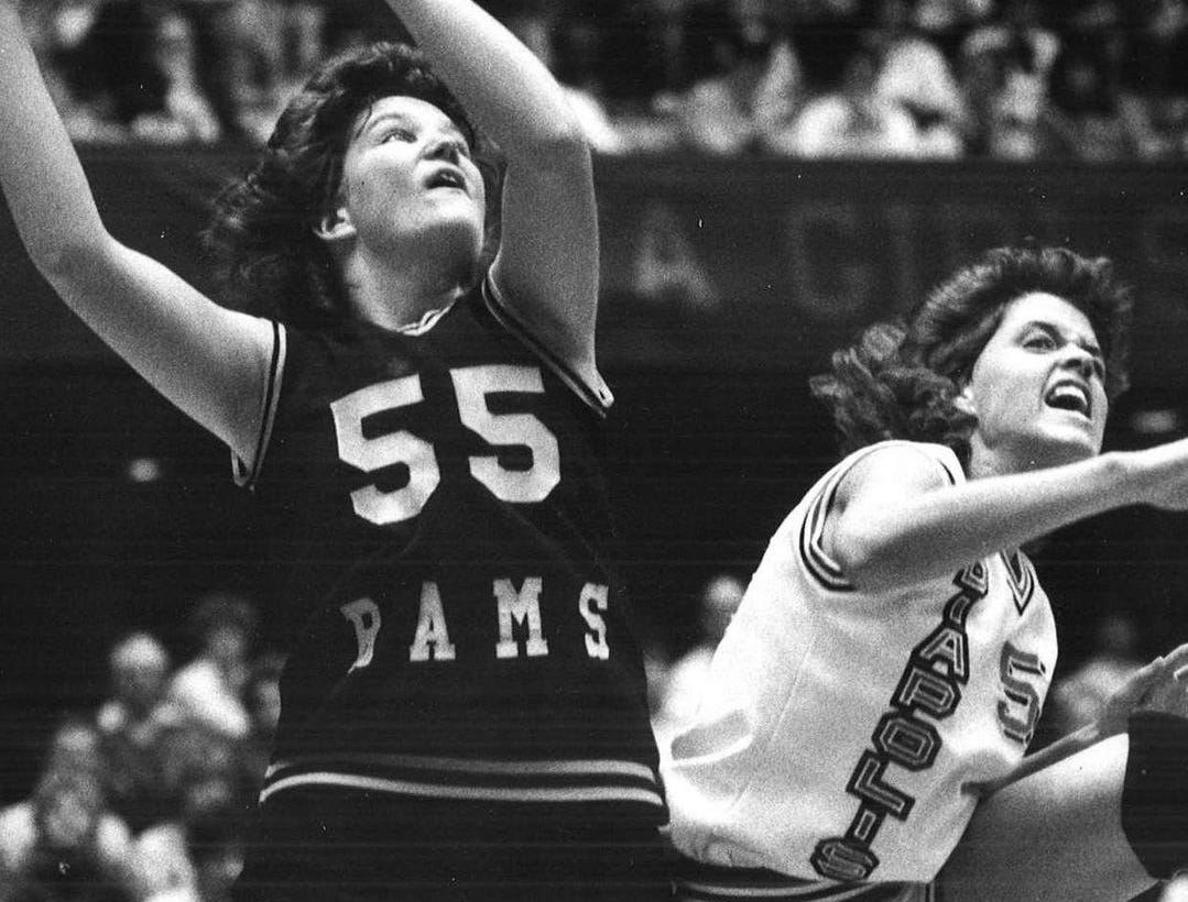1987: Heather Adair, of Southeast Polk, (55) goes up for a shot while Mediapolis' Denise Edle defends during the state girls' semifinals. Register file photo