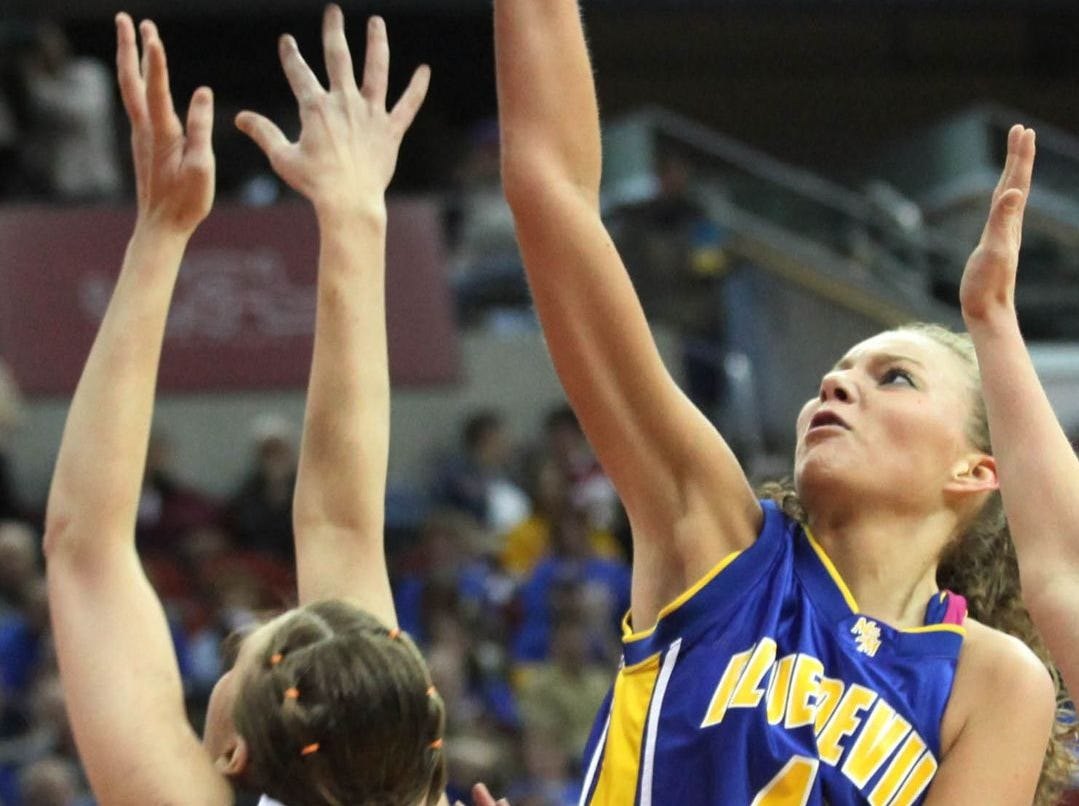 2009: Springville's Katie Eiben has her shot blocked by Mackenzie Morrison, of Martensdale-St. Marys, in their 1A quarterfinal at the state girls' basketball tournament. Register file photo
