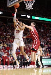 Oklahoma Sooners forward Matt Freeman (5) defends the shot of Iowa State Cyclones guard Tyrese Haliburton (22) at Hilton Coliseum.