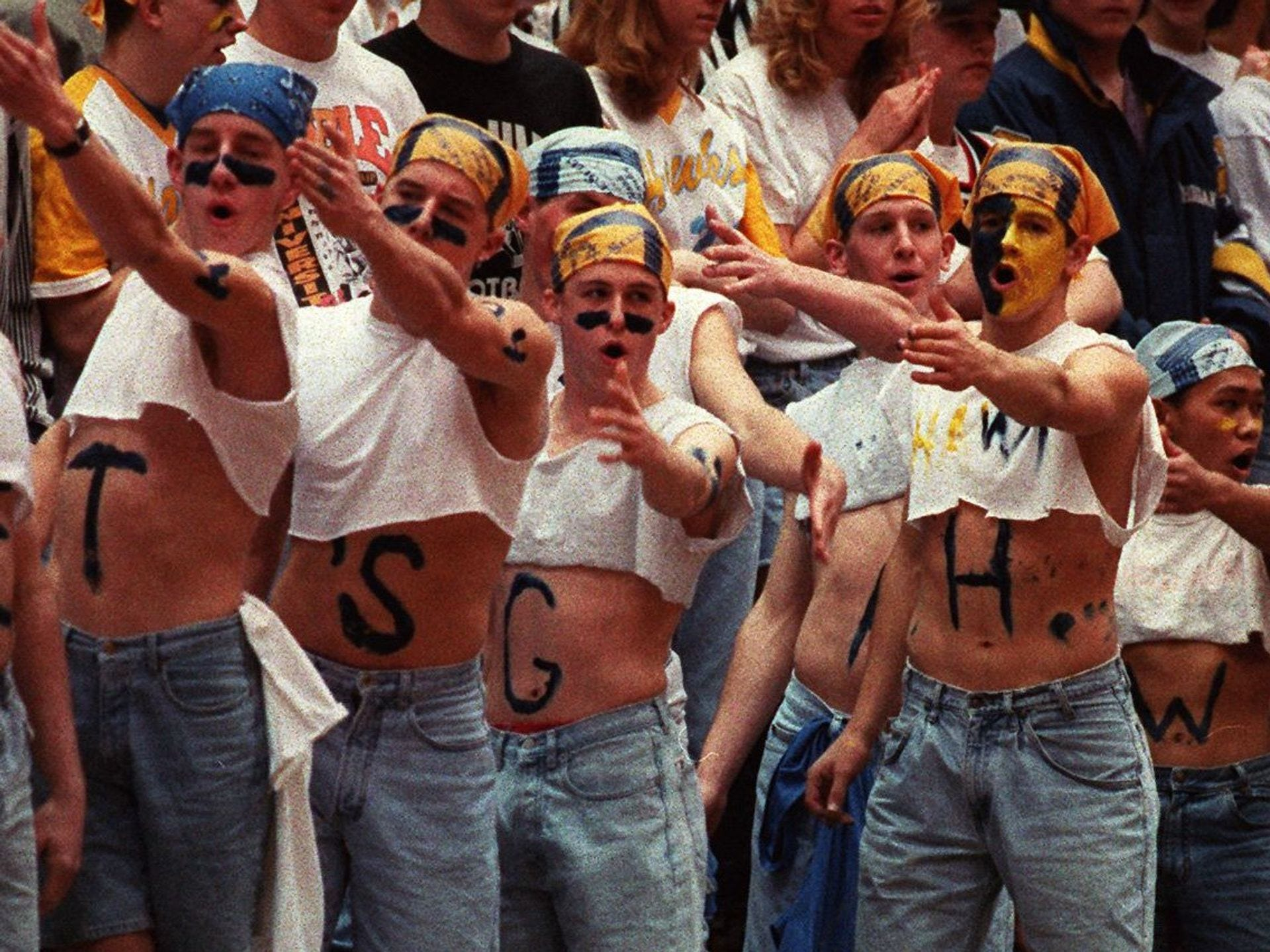 "1996: A group of boys spells ""Let's go Hawkettes"" to show their support for Lynnville-Sully at the state girls' basketball tournament. Lynnville-Sully beat IKM of Manilla, 54-51. Register file photo"
