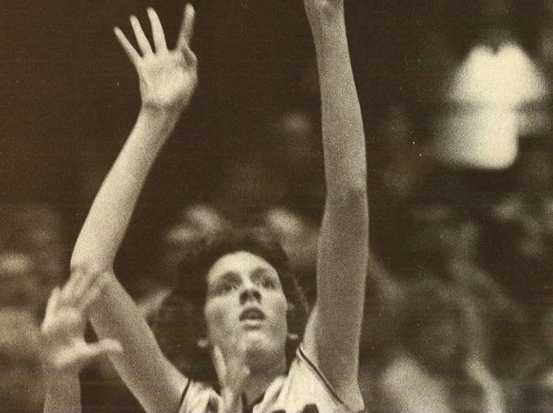 1977: Southeast Polk's Rae White displays a delicate touch as she launches a shot over West Burlington's Tammy Crafton. White helped propel fifth-ranked Southeast Polk to a 54-48 upset, West Burlington's first defeat in 28 games. Register file photo