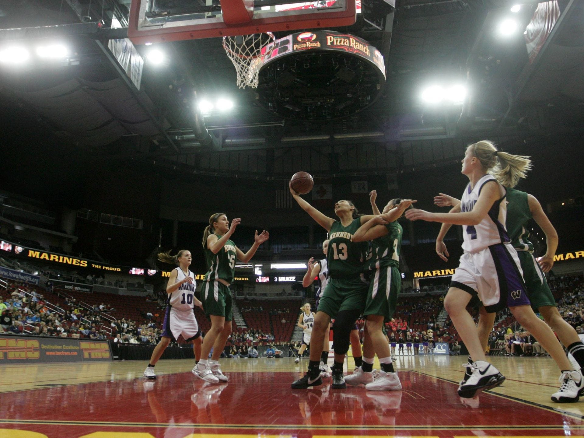 2009: Cedar Rapids Kennedy's Jade Rogers gets a rebound under the Waukee basket in their 4A quarterfinal game at the state girls' basketball tournament. Register file photo