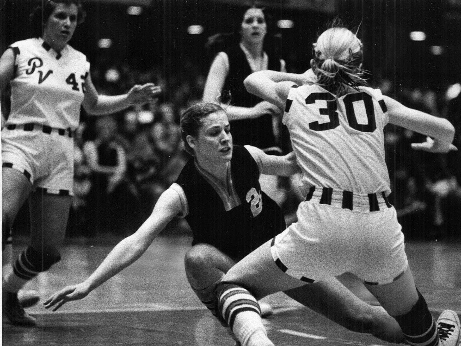 1978: Pleasant Vinton's Lisa Lau, left, and Pleasant Valley's Donna Ven Horst brace after colliding. Valley lost 71-62. Register file photo
