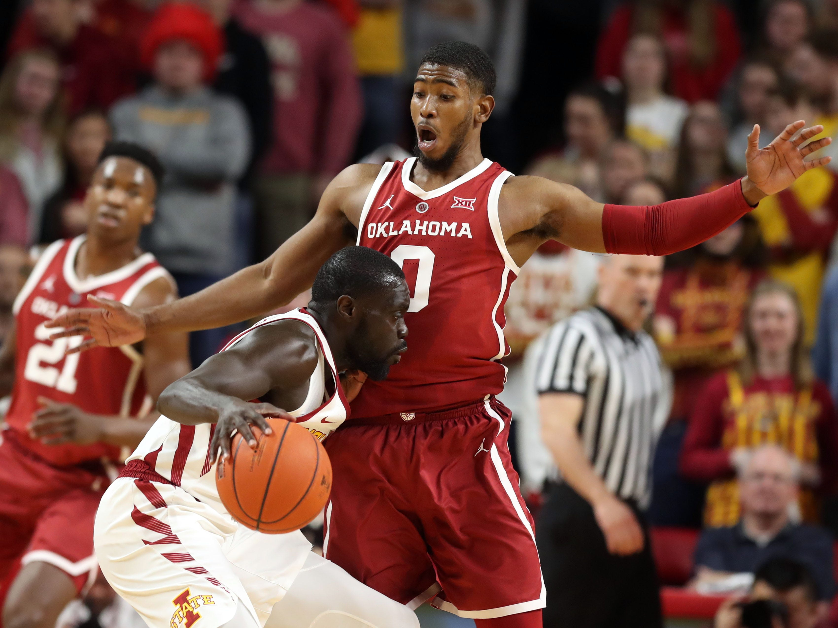 Oklahoma Sooners guard Christian James (0) defends Iowa State Cyclones guard Marial Shayok (3) at Hilton Coliseum. The Cyclones beat the sooners 78 to 61.