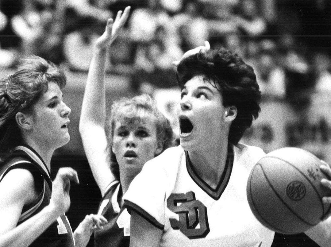 1986: Sibley-Ocheyedan's Sarah Van Diepen (54) eyes the basket over Lynn Blacke. Register file photo