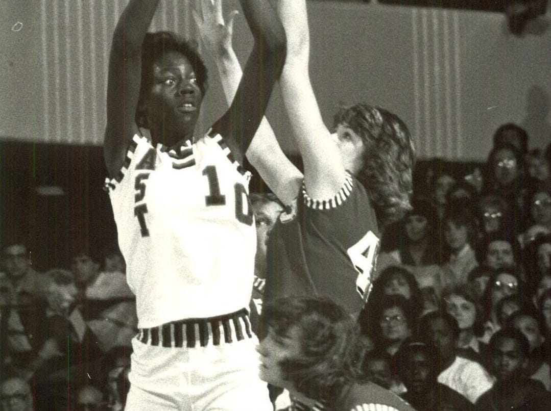 1982: EastÕs Opie Lowery has her shot blocked by EsthervilleÕs Debi Niles during a state girlsÕ basketball tournament game. Register file photo