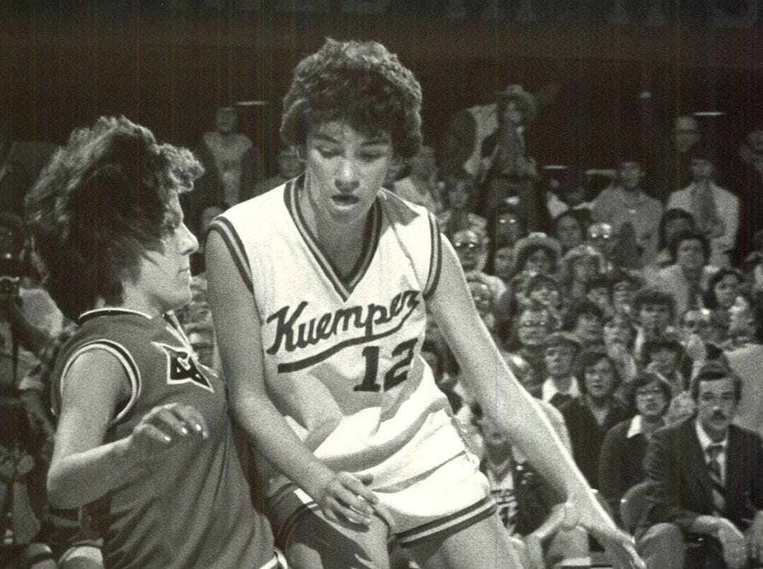 1981: Terri Heisterkame of Kuemper tries to drive past Rachel Baron of Charles City in a state girlsÕ basketball tournament game. Register file photo