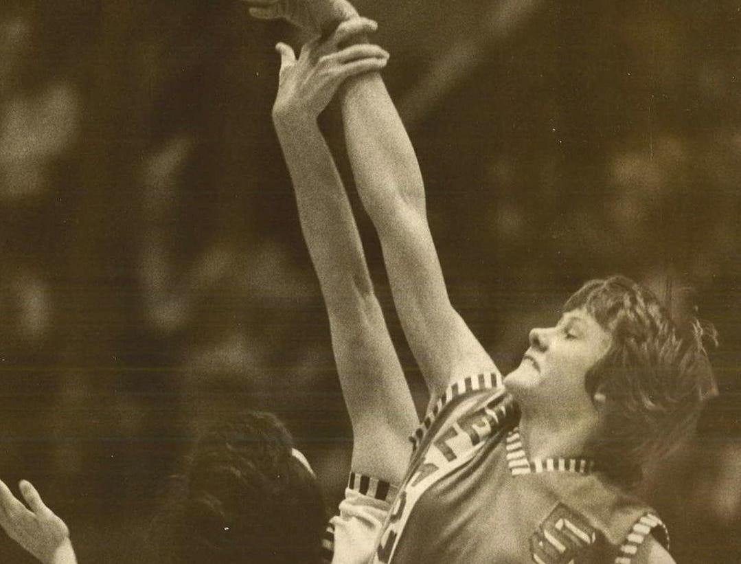 1977: Belmond's Gloria Suntken, right, beats Ankeny's Tina Bertogli to tip on a jump ball during the state girls' basketball tournament. Register file photo