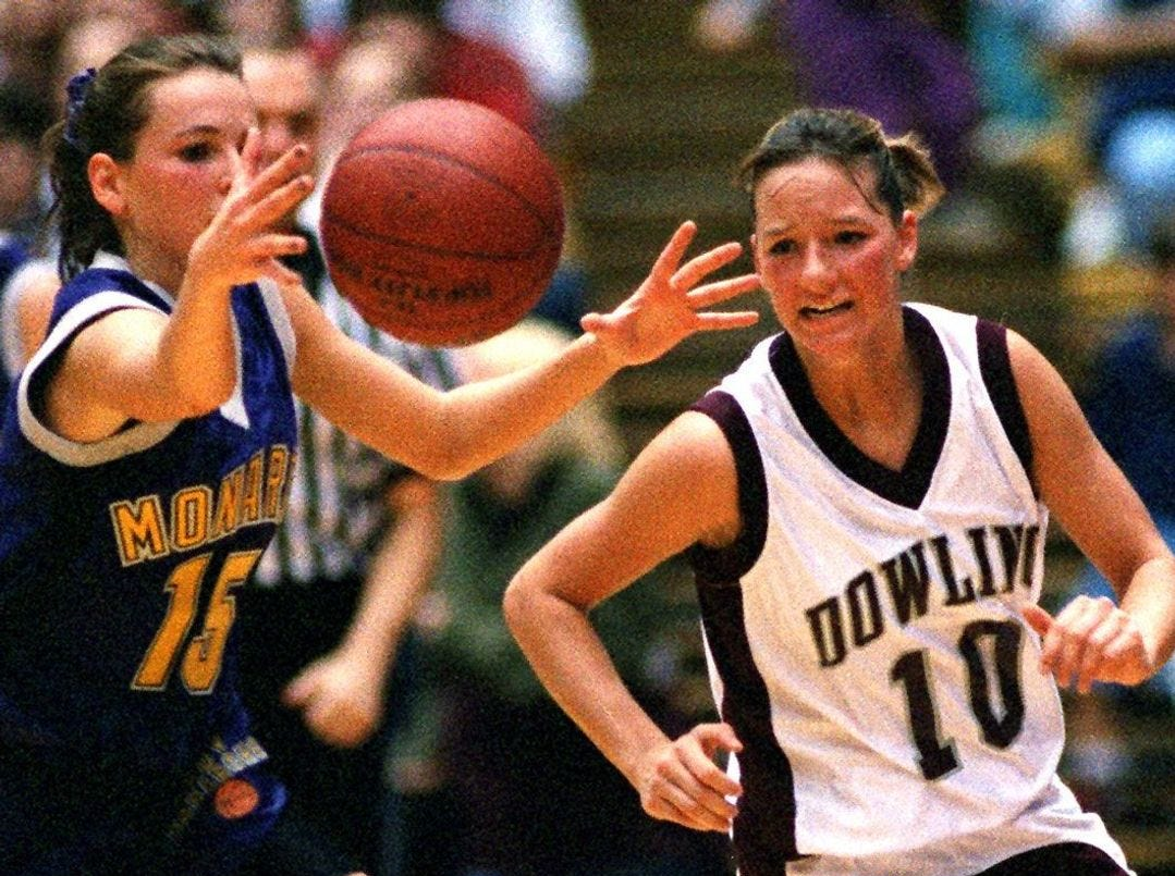 1998: Denison-Schleswig's Jenn Gronau reaches for a loose ball as Dowling's Kara Opp gives chase during the Class 4-A championship game. Register file photo