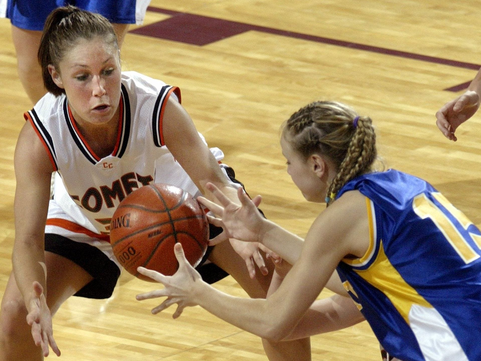 2004: Charles City's Marlowe Brooks and Dubuque Wahlert's Angie White try to get control of a loose ball at the state girls' basketball tournament. Register file photo