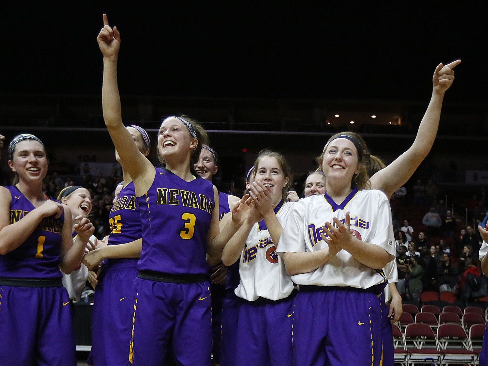 Nevada celebrates after defeating Center-Point Urbana during a Class 3A semifinal game of the Iowa Girls' High School State Basketball Tournament at Wells Fargo Arena in Des Moines, Thursday, March 3, 2016. Register file photo