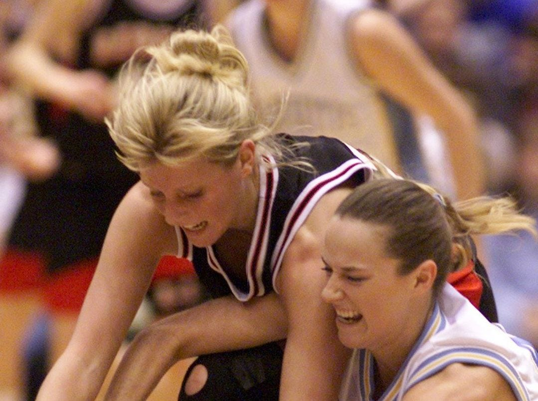 1999: Lynnville-Sully's Carrie Norman, right, battles Rockwell-Swaledale's Ashley Stiles for the basketball. Register file photo