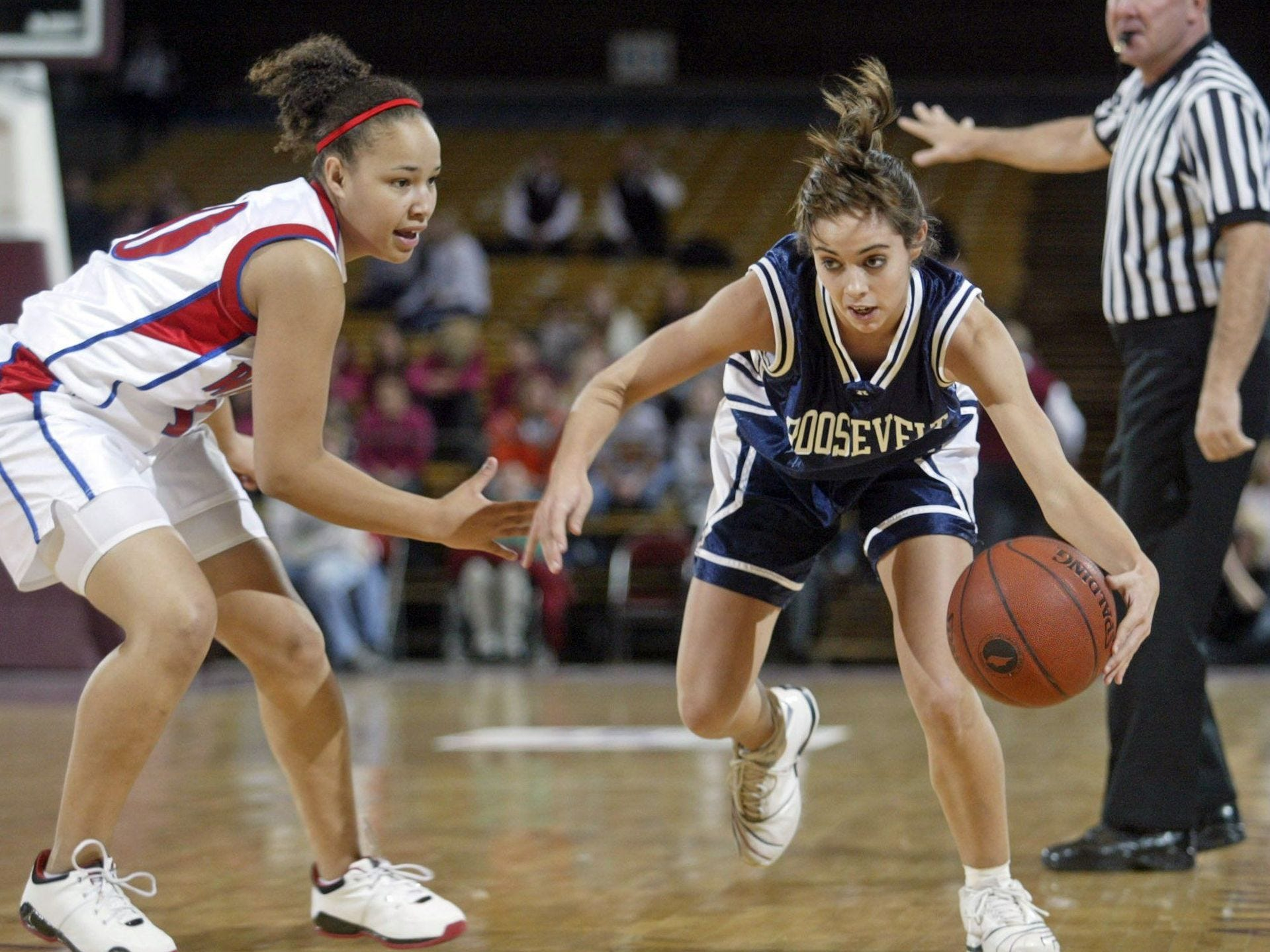 2005: Rider Christina Brown drives against Warrior Micha Mims at the state girls' basketball tournament. Register file photo