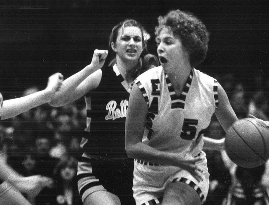 1980: Lorri Bauman drives against Bettendorf's Lisa Irvine (11) and Sue Block. East won 74-55. Register file