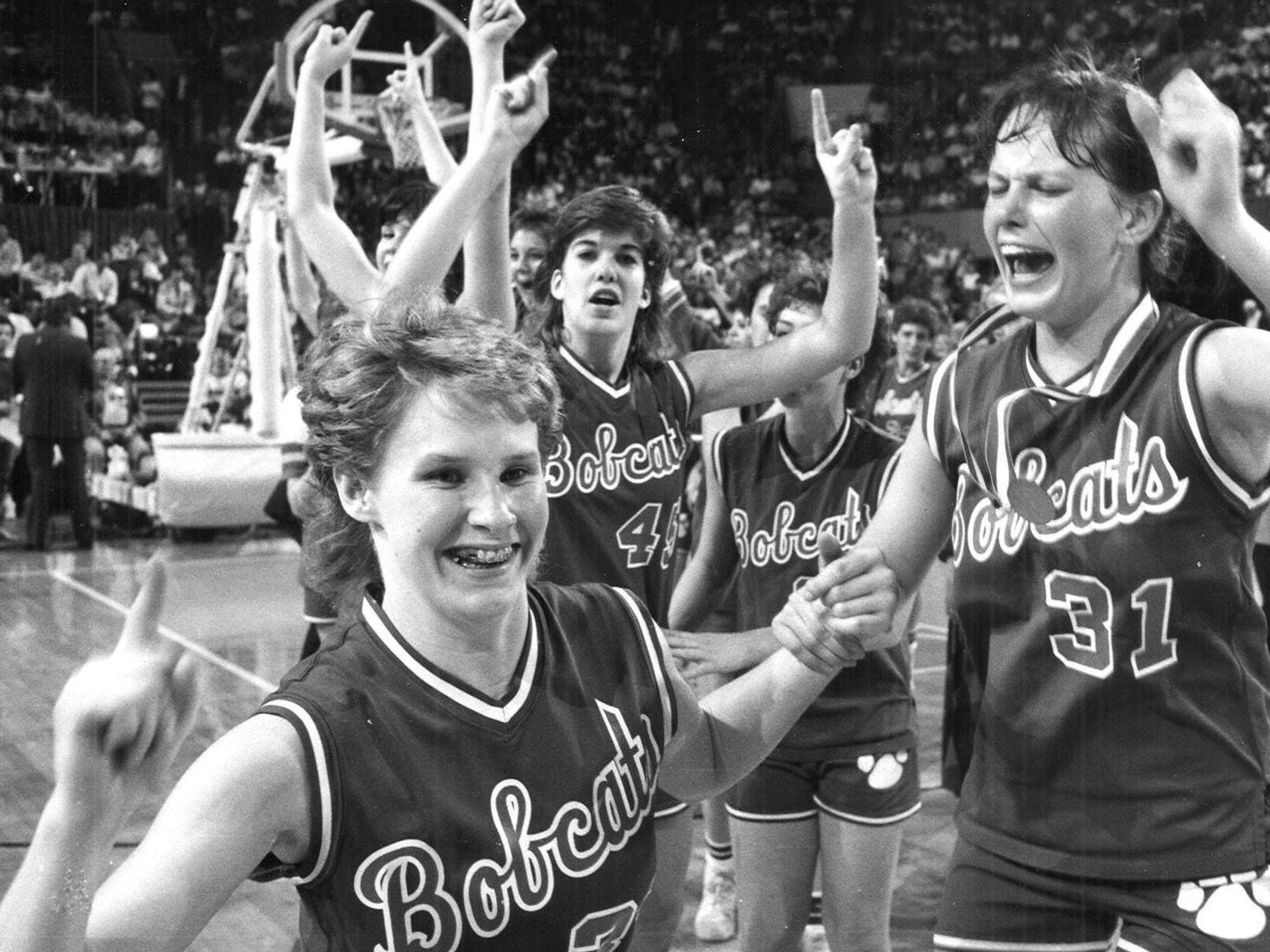 1986: Kirsten Beach, Darcy Burns and Missy Sharer (31) celebrate Bobcat victory. Register file photo