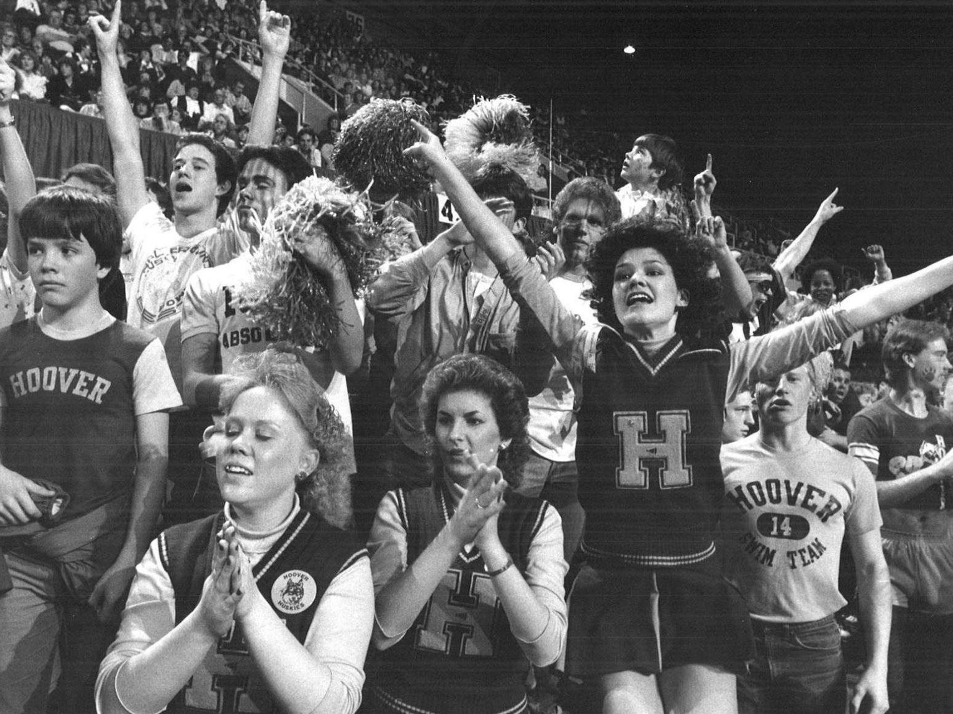 1983: Hoover fans cheer on their team during a state girlsÕ basketball tournament game. Register file photo