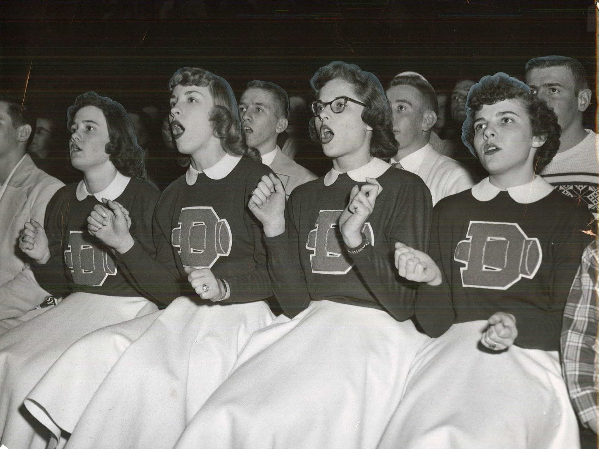 1956: Donnellson cheerleaders are caught up in the excitement of a state girlsÕ basketball tournament game against Valley. Left to right are Marilyn Klingler, Janet Taylor, Marjorie Krehbiel and Pat Murphy. Register file photo