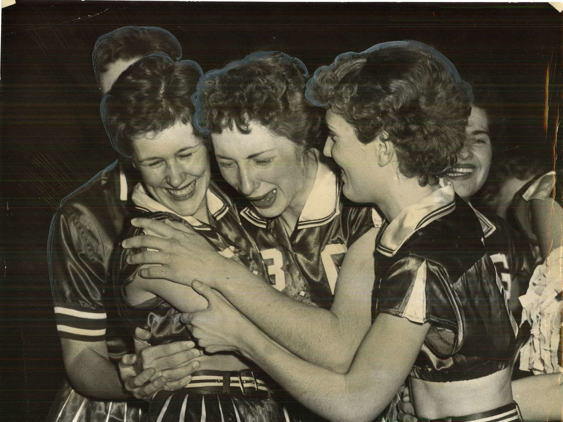 1957: Garrison player Barbara Beyer, center, cries after her teamÕs win over Maynard in the state girlsÕ basketball tournament. She is surrounded by teammates Sylvia Froning and Delores Selk. Register file photo