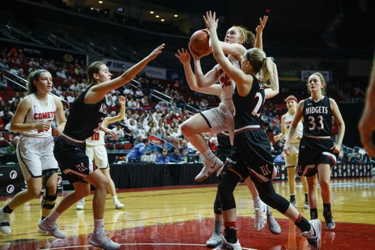 North Polk's Maggie Phipps (32) shots during their first round girls state championship basketball game on Monday, Feb. 25, 2019 in Des Moines. North Polk takes a 23-18 in to halftime.