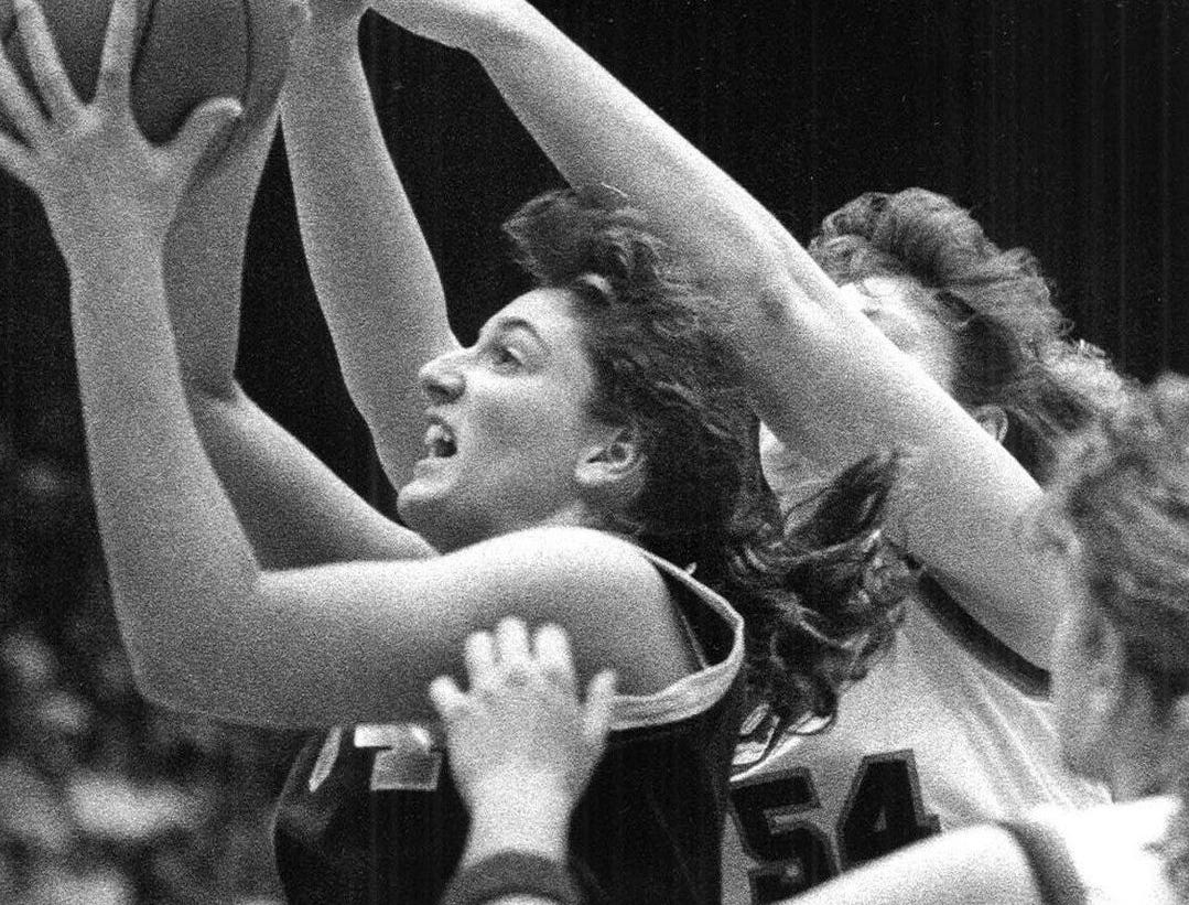 1990: Mary Reuter, of Waterloo Columbus, drives toward the basket past Cedar Rapids Jefferson defender Amy Langguth (54) and Kate Galligan during the title game. Waterloo Columbus won, 63-58. Register file photo