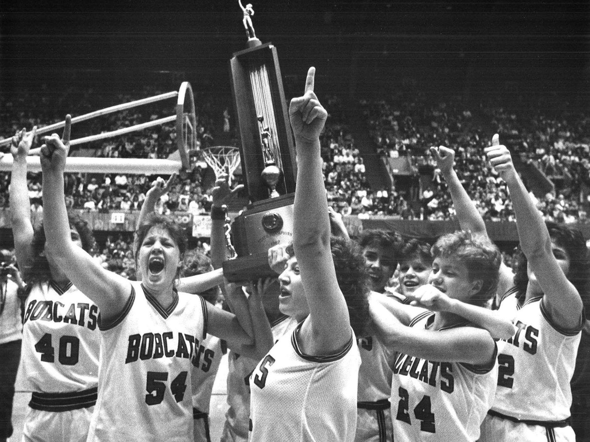 1987: Western Dubuque players hold their trophy after a victory in the state girlsÕ basketball tournament. Register file photo