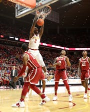 Iowa State Cyclones forward Cameron Lard (2) dunks over the top of Oklahoma Sooners guard Christian James (0) at Hilton Coliseum.