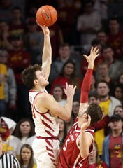 Iowa State Cyclones forward Michael Jacobson (12) shoots over the top of Oklahoma Sooners forward Matt Freeman (5) at Hilton Coliseum. The Cyclones beat the sooners 78 to 61.