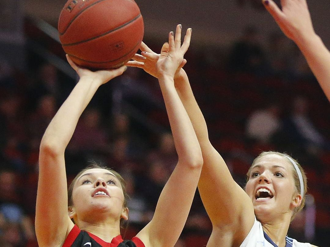 West Branch's Paige Miller makes her way past Unity Christian's Anna Kiel during the Iowa Girls' High School State Basketball Tournament at Wells Fargo Arena in Des Moines, Monday, Feb. 29, 2016. Register file photo
