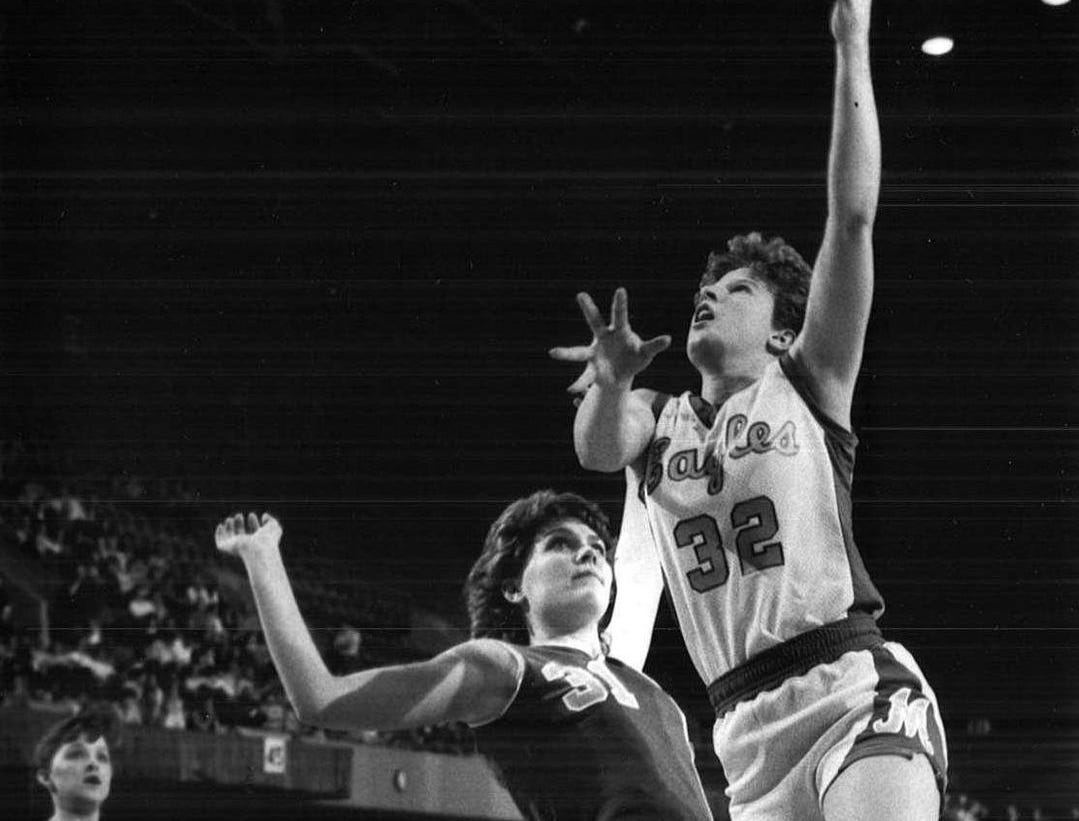 1986: Cheryl Dreckman, of Marcus, lays the ball up on DenisonÕs Pam Bernholtz during a state girlsÕ basketball tournament game. Register file photo