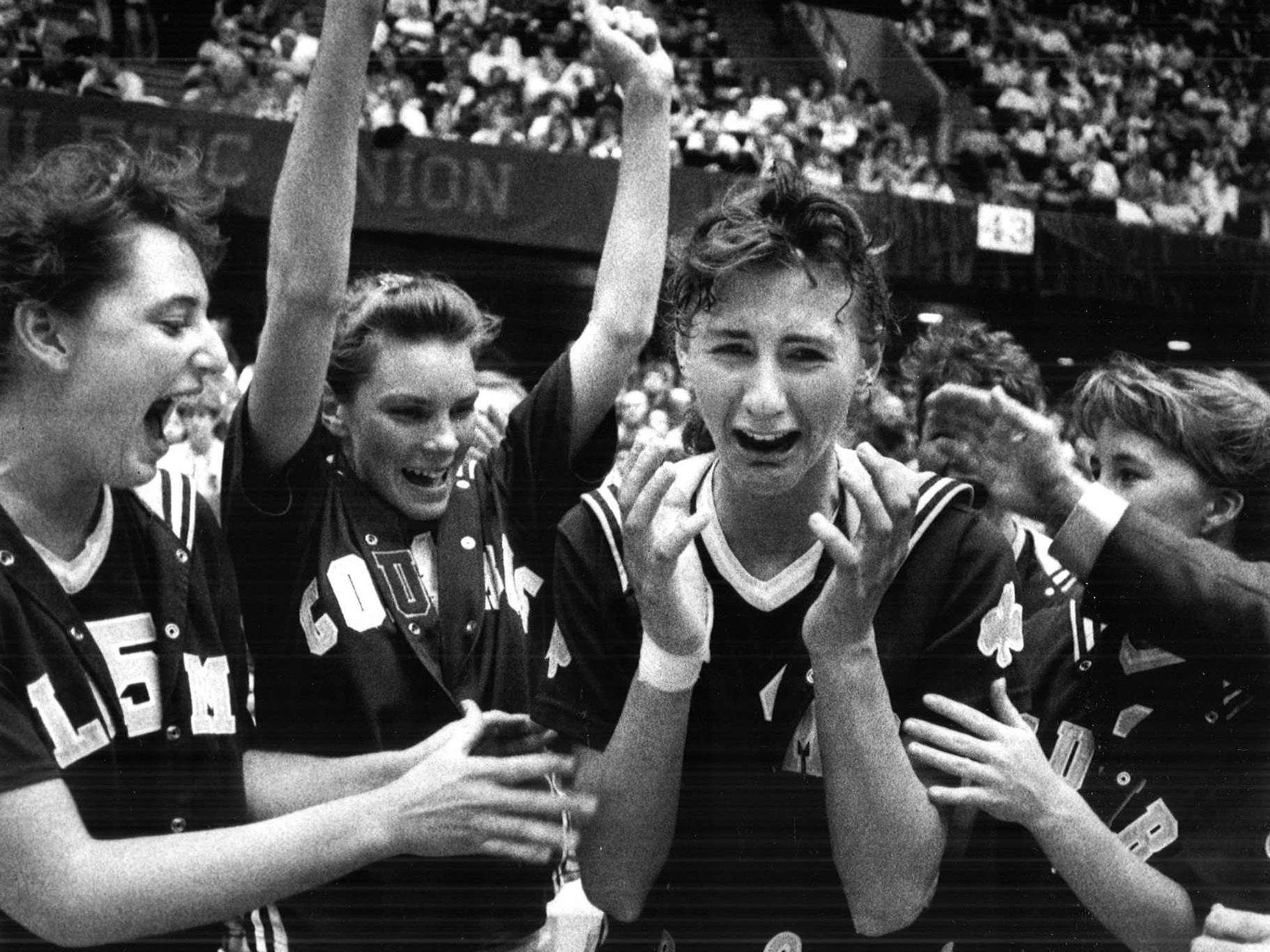 1990: Lisa Demuth of Waterloo Columbus, center, reacts as she is named captain of the all-tournament team, moments after Demuth led the Sailors to a championship against Cedar Rapids Jefferson, 63-58. Register file photo