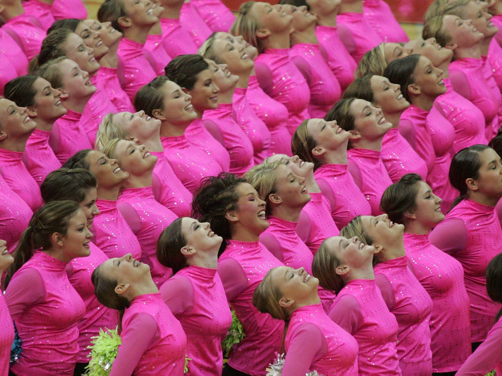 2008: Some of the 274 members of the All-Iowa Honor Dance Team perform at halftime of the the 3-A title game at the girl's high school basketball tournament. Register file photo