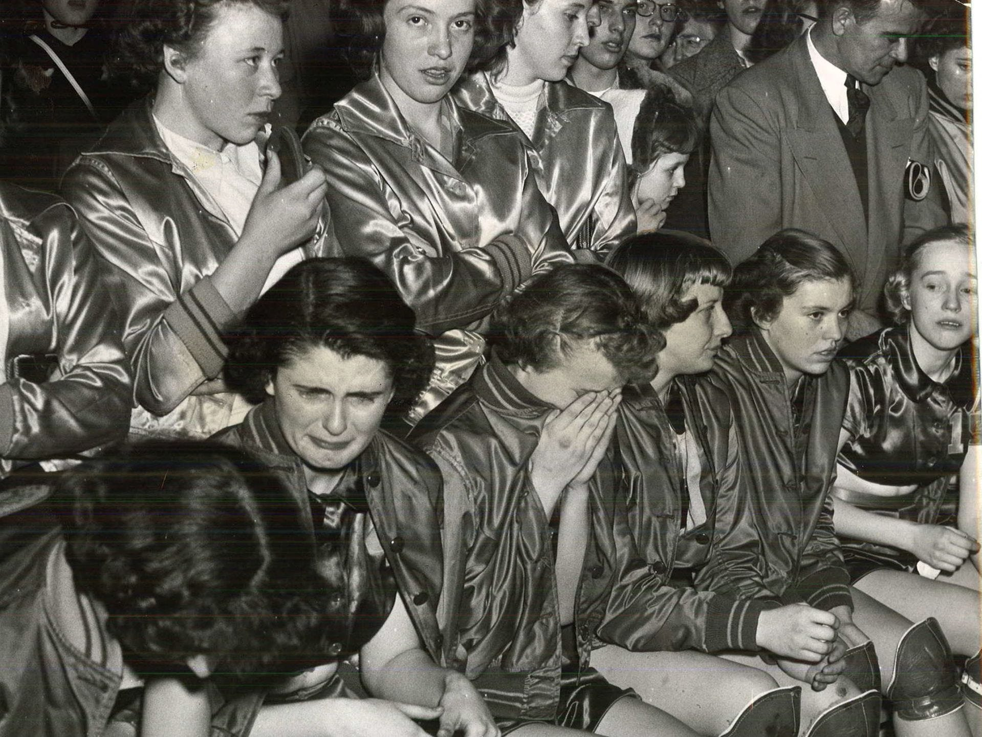 1952: The Monona girlsÕ basketball team mourns their loss to Reinbeck in the state girlsÕ basketball tournament. From left are: Norma Schoulte, Carole Gilbert, Joanita Blumhagen, Marjorie Fett, Sharon Le Moon, Nancy Riedesel and Dorothy Hubacher. Register file photo