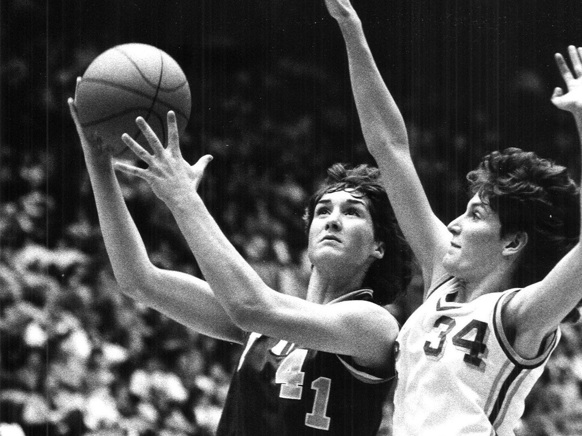 1986: Indianola's Carol Seymour gets a shot over Angee Brauman of LaPorte City. Register file photo