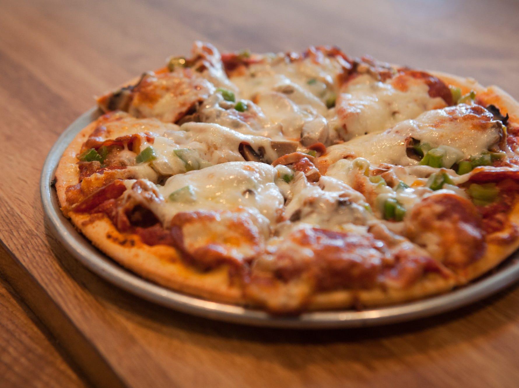 A small combo pizza with sausage, mushroom, onion, green pepper and pepperoni. Scott Morgan/Special to Juice A small combo pizza with sausage, mushroom, onion, green pepper and pepperoni Tuesday, Feb. 12, 2013, at Scornovacca's Ristorante in Des Moines.
