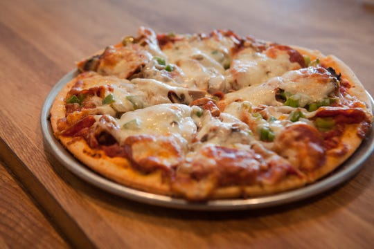 A small combo pizza with sausage, mushroom, onion, green pepper and pepperoni t Scornovacca's Ristorante in Des Moines.