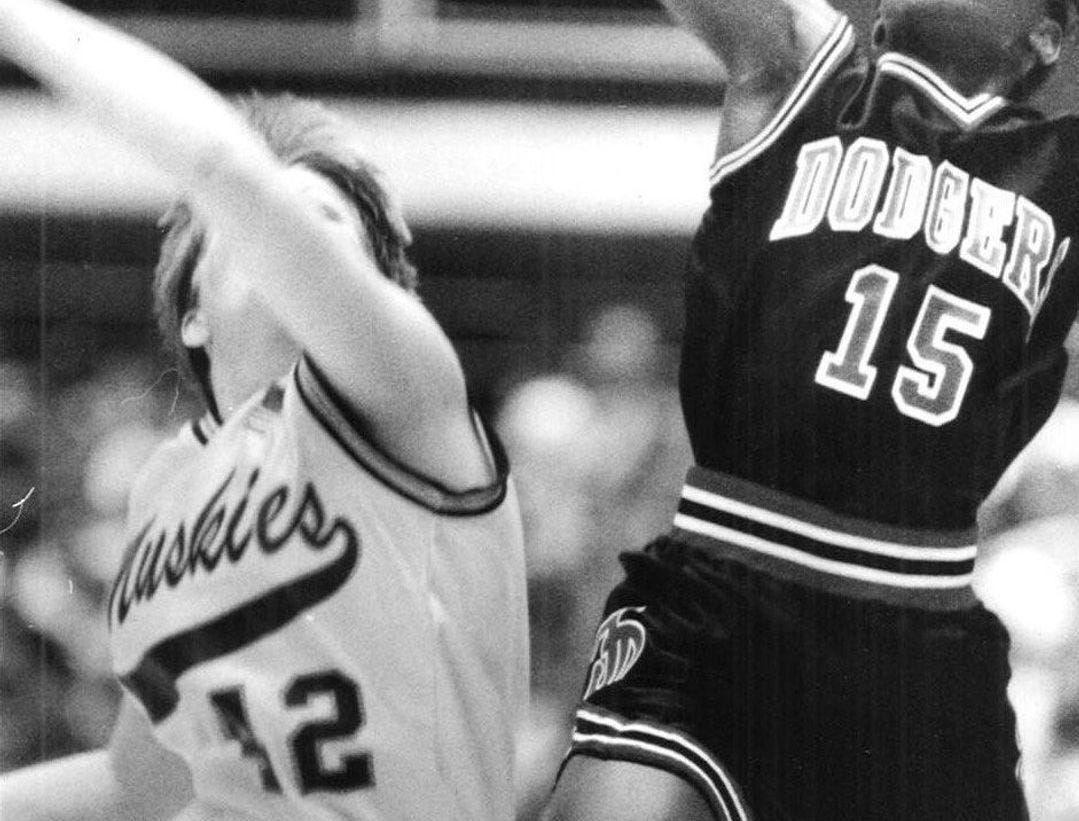 1991: Nikki Dillard (15) of Fort Dodge and Teneall Lloyd (12) of Muscatine battle for a loose ball in their game at the state girls' basketball tournament. Register file photo