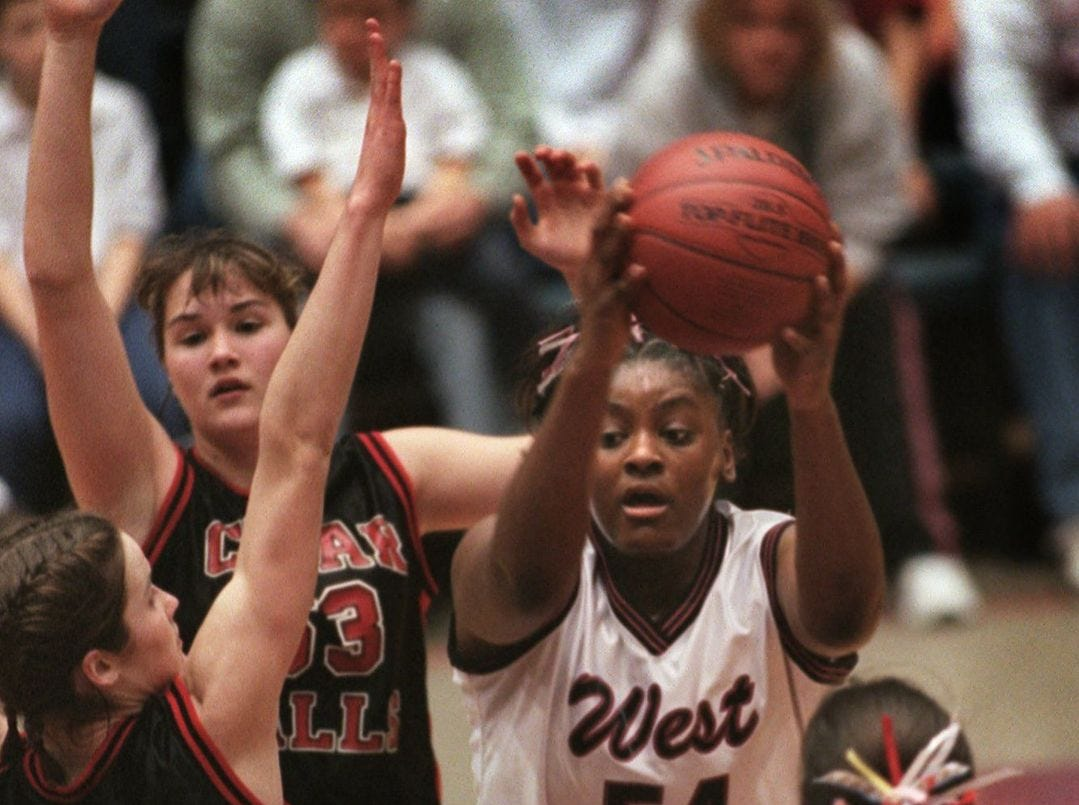 1999: Cedar Falls' Ellie Peterson (41) applies defense against Waterloo West's Nina Smith during Thursday's game. Register file photo