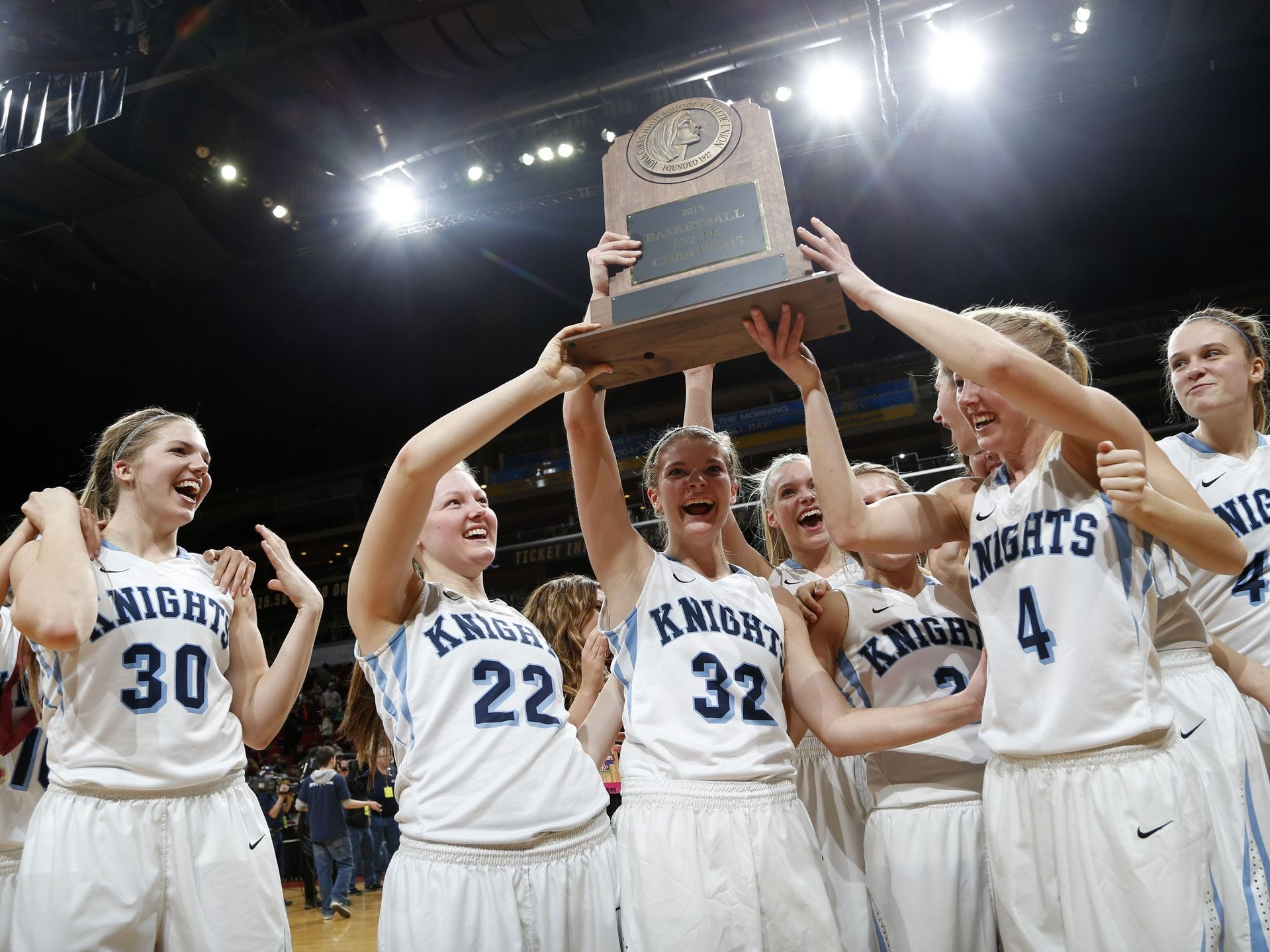 Unity Christian players celebrate their 2A state title win over North Linn Friday, March 6, 2015 at Girls State Basketball Tournament at Wells Fargo Arena in Des Moines. Michael Zamora/The Register