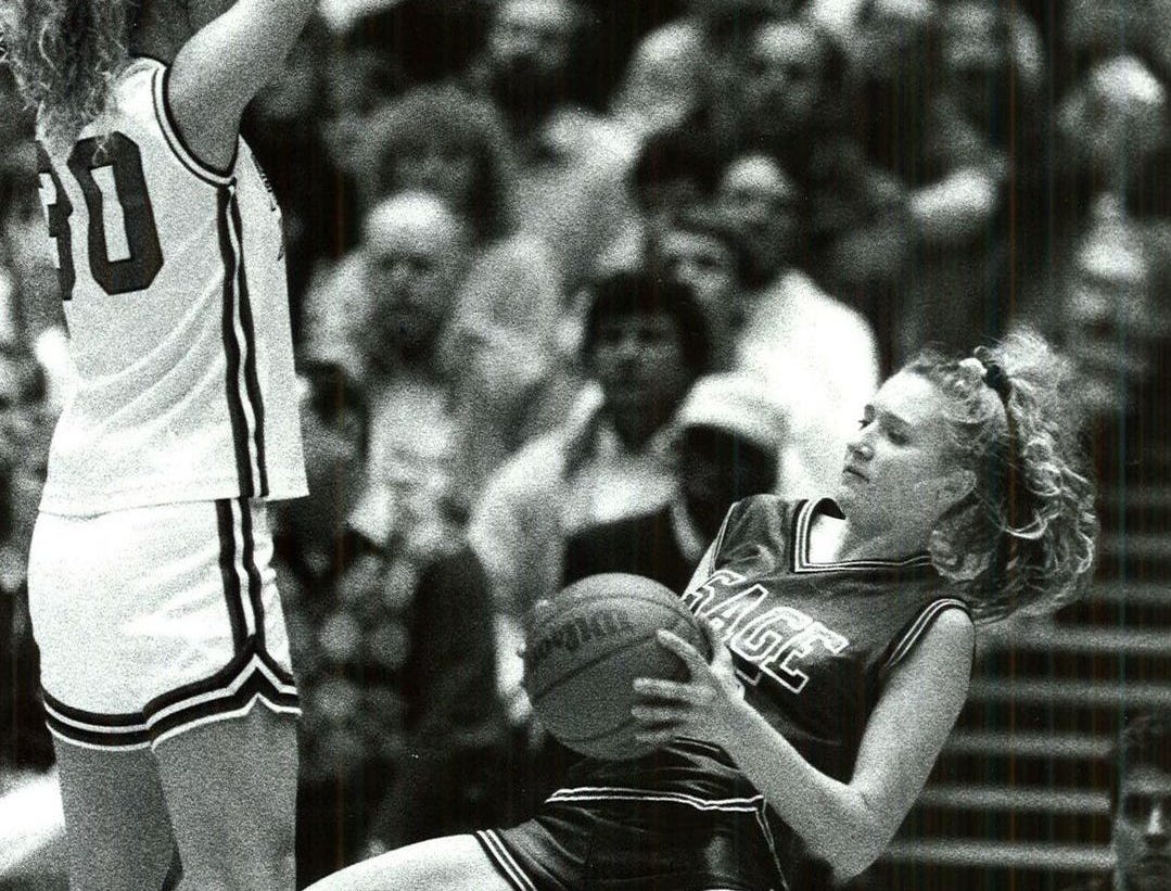 1992: Osage's #45 April Hintz tries to keep her feet under her as Hampton-Dumont's #30 Ivy Mennen defends at the state girls' basketball championship. Register file photo