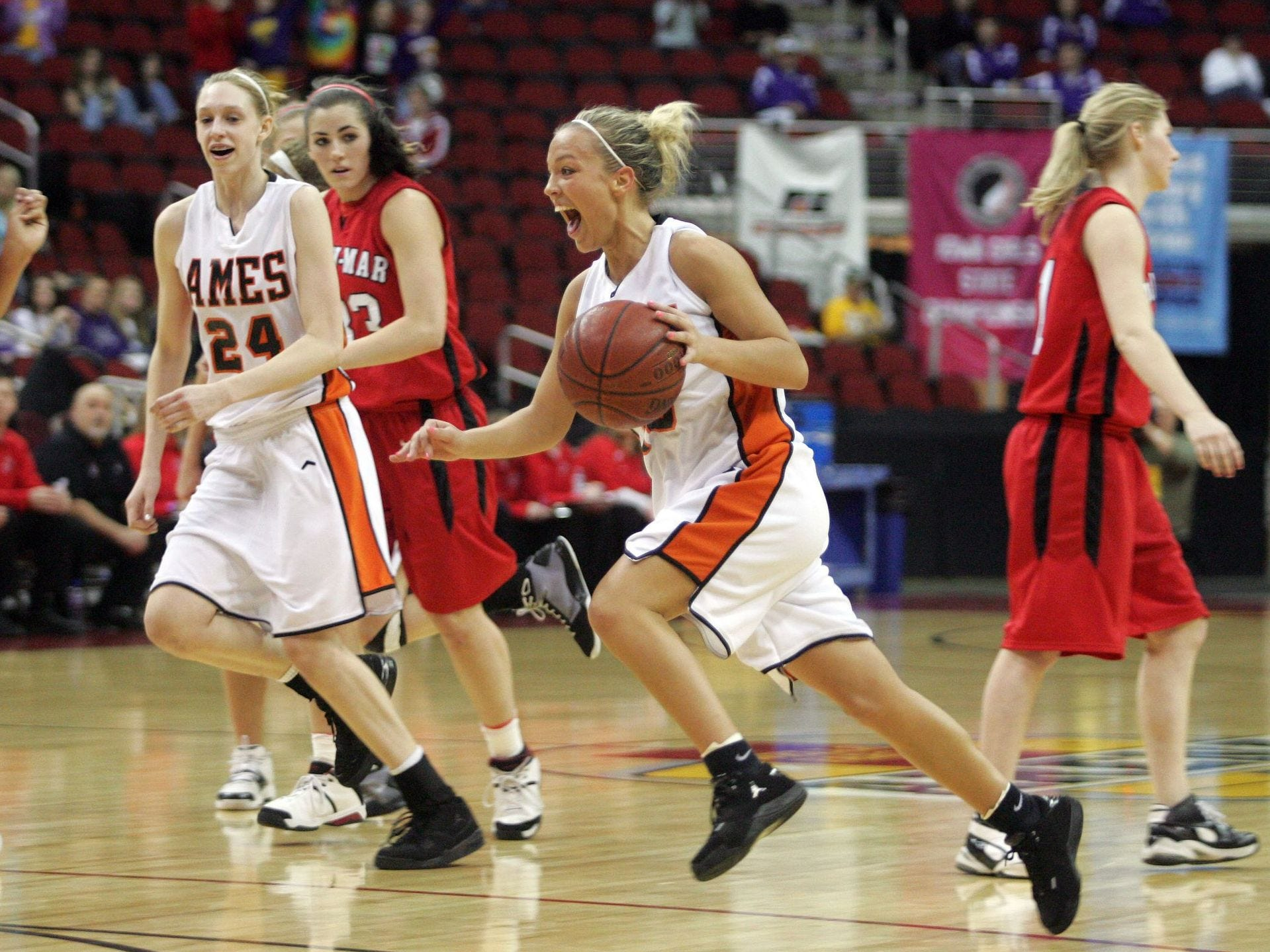 2009: Ames' Trisha Nesbitt dribbles the ball out at the buzzer as Ames upsets undefeated Linn-Mar during the Class 4A semifinals at the state girls' basketball tournament at Wells Fargo Arena . Register file photo