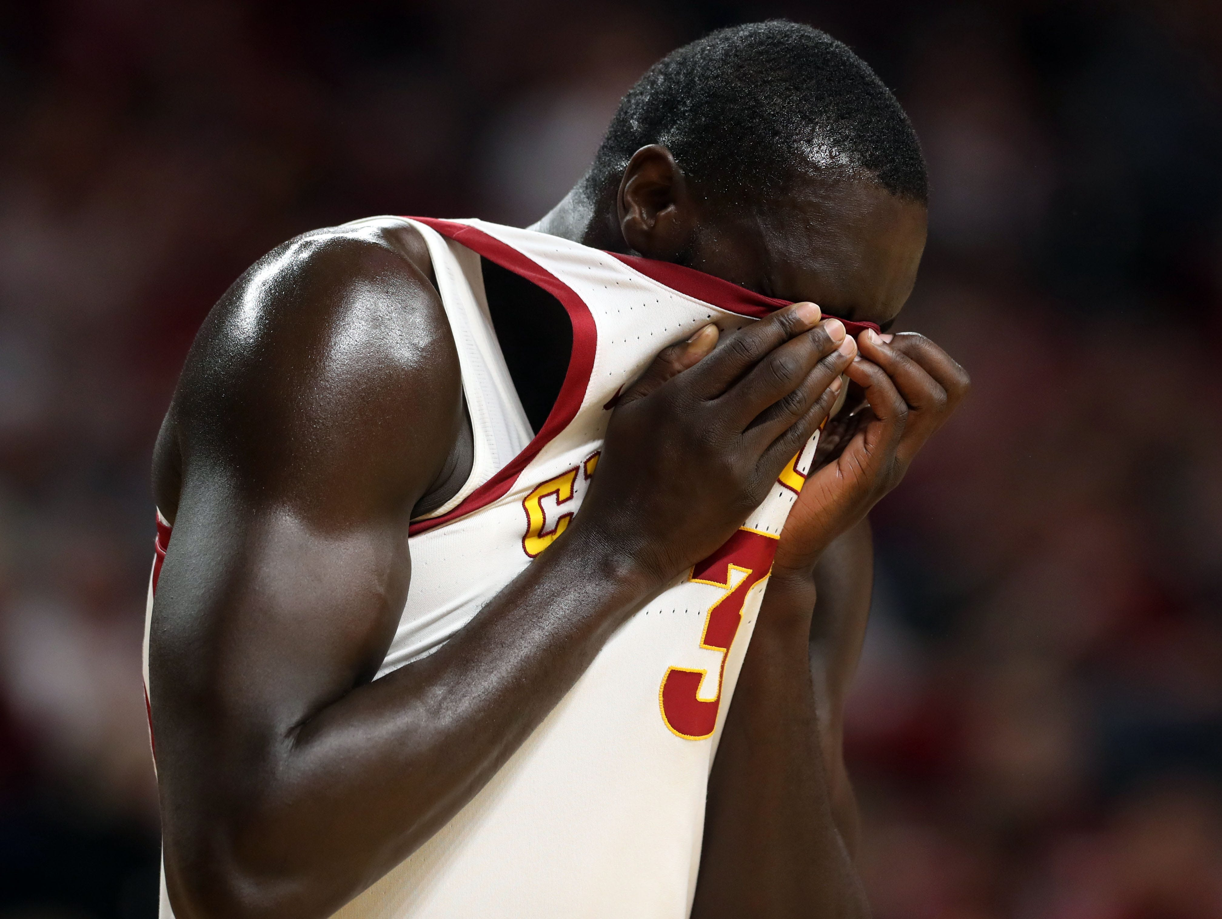 Iowa State Cyclones guard Marial Shayok (3) wipes his face in the second half against the Oklahoma Sooners at Hilton Coliseum. The Cyclones beat the sooners 78 to 61.