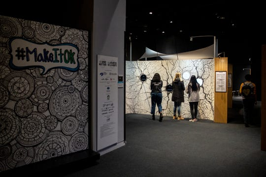 High school students from central Iowa make their way through the Science Center of Iowa's special exhibition Mental Health: Mind Matters on Monday, Feb. 26, 2019, in Des Moines. The exhibit is meant to proved a hands on experience for learning more about mental illness.