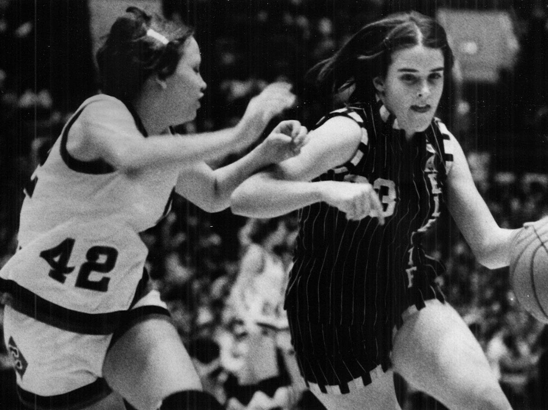 1978: Gaelettes' Nancy Eide navigates past Creston's Terri Austin at the state girls' basketball tournament. Register file photo